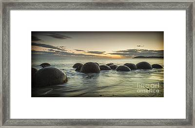 Moeraki Boulders New Zealand At Sunrise Framed Print by Colin and Linda McKie