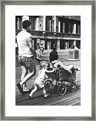 Mom's Turn For Ride Framed Print by Underwood Archives
