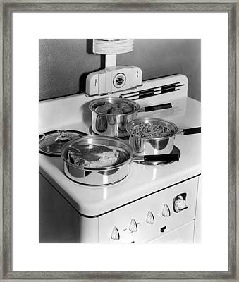 Monarch Stove Top With Dinner Framed Print by Underwood Archives