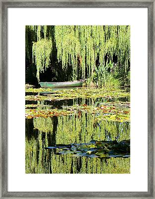 Monet's Pond Framed Print by Lorella  Schoales