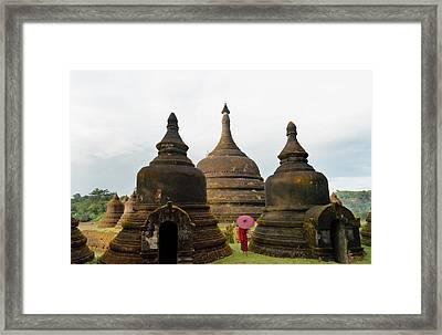 Monk Holding Red Umbrella Framed Print by Keren Su