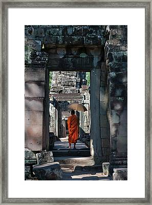 Monk With Buddhist Statues In Banteay Framed Print by Keren Su