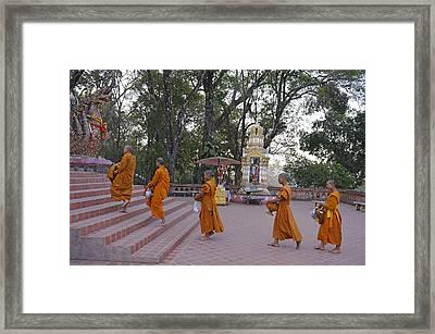 Monks Framed Print by Christian Heeb