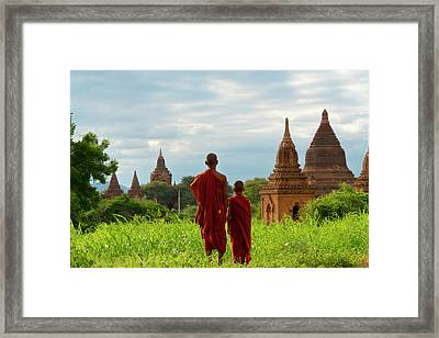 Monks With Ancient Temples And Pagodas Framed Print by Keren Su