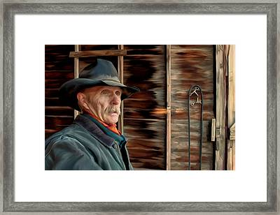 Montana Cowboy Framed Print by Michael Pickett