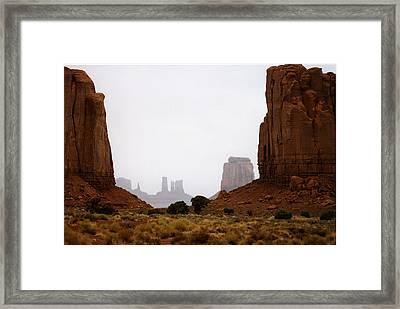 Monument Valley Mist Framed Print by Robert Lozen