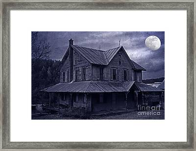 Moody Moonlit Mansion Framed Print by John Stephens