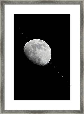 Moon And The Iss Framed Print by Nasa
