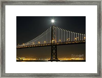 Moon Atop The Bridge Framed Print