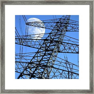 Moon Behind Electricity Pylons Framed Print