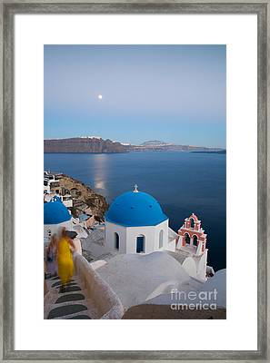 Moon Over Blue Domed Church In Oia Santorini Greece Framed Print by Matteo Colombo