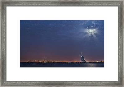 Moon Over Dubai Skyline Framed Print by Babak Tafreshi