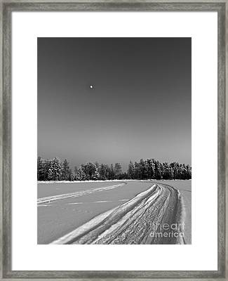Moon Over Ice Road Framed Print