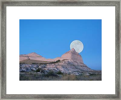 Moon Over The Monument Framed Print