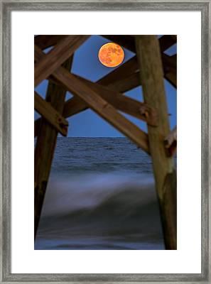 Moon Rise Under Pier Framed Print