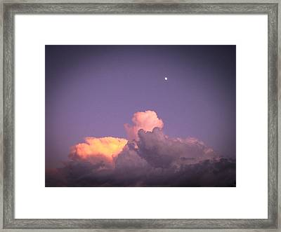 Moon Speck Framed Print