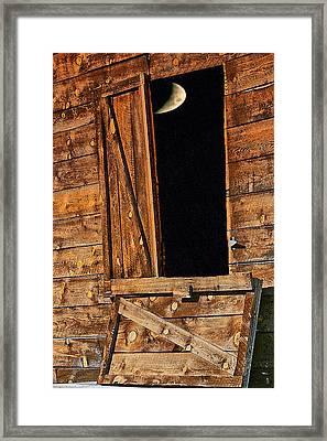 Moon Through The Barn Door Framed Print