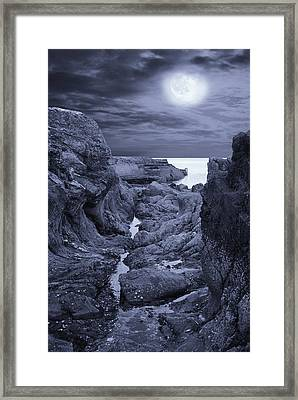 Framed Print featuring the photograph Moonlight Over Rugged Seaside Rocks by Jane McIlroy