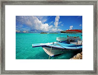 Moored Dhoni At Sun Island. Maldives Framed Print by Jenny Rainbow