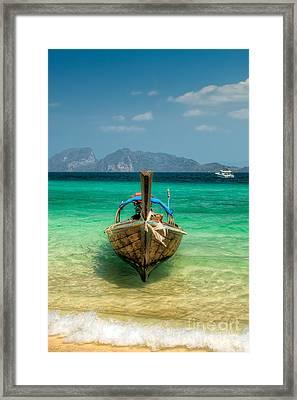 Moored Longboat Framed Print by Adrian Evans