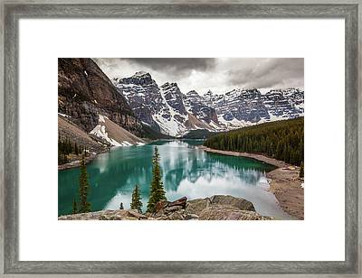 Moraine Lake On Cloudy Day Framed Print by Putt Sakdhnagool