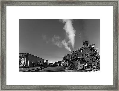 Distant Moon At Train Yard Framed Print by Robert Frederick
