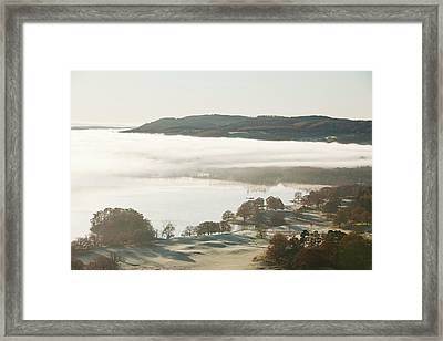 Morning Mist Over Lake Windermere Framed Print by Ashley Cooper