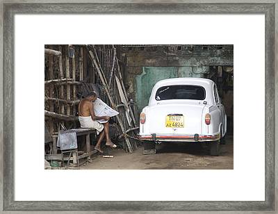 Morning News Framed Print by Lee Stickels
