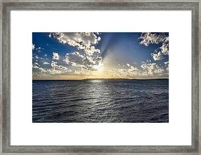 Morning Sun Punching Through The Clouds In St. Croix Framed Print