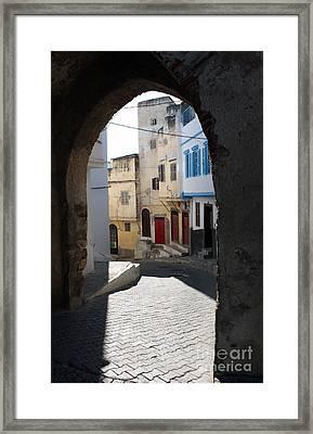 Morocco Door Light Framed Print by Joe Fantauzzi