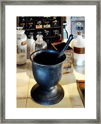 Mortar And Pestle Near Medicine Bottles Framed Print by Susan Savad