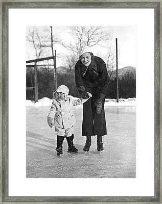 Mother & Daughter Ice Skating Framed Print by Underwood Archives