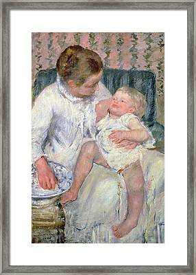 Mother About To Wash Her Sleepy Child Framed Print by Mary Stevenson Cassatt