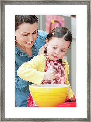 Mother And Daughter Baking Framed Print by Ian Hooton