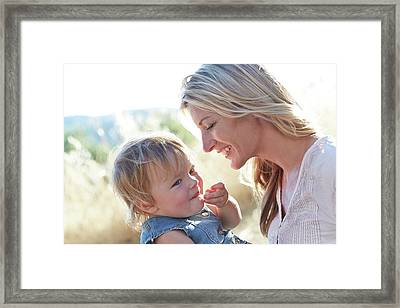 Mother And Daughter Laughing Framed Print by Ruth Jenkinson