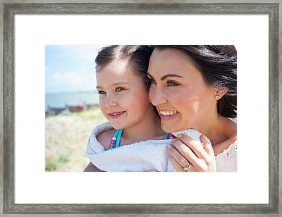 Mother And Daughter Smiling Framed Print