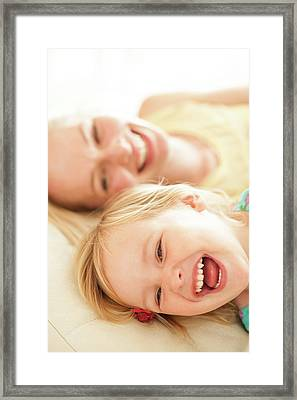 Mother And Her Daughter Laughing Framed Print by Ian Hooton