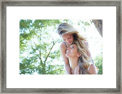 Mother Carrying Daughter Framed Print