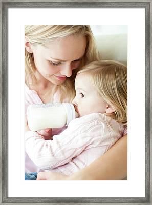 Mother Feeding Daughter With Bottle Framed Print