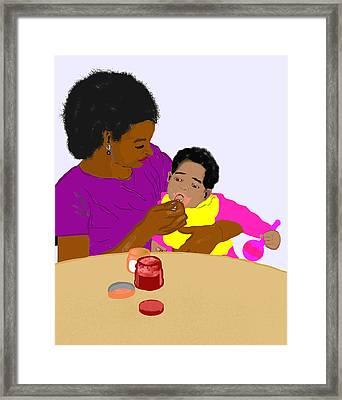 Mother Feeding Her Baby Framed Print by Pharris Art