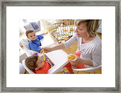 Mother Feeding Twin Baby Sons Framed Print by Aj Photo