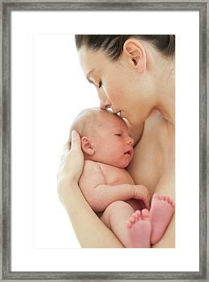 Mother Holding Newborn Baby Boy Framed Print by Ian Hooton