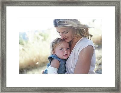 Mother Hugging Daughter Framed Print