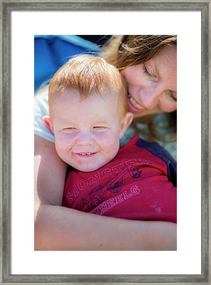 Mother Hugging Toddler With Red Hair Framed Print by Samuel Ashfield