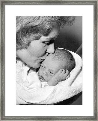Mother Kissing Baby Framed Print by Underwood Archives