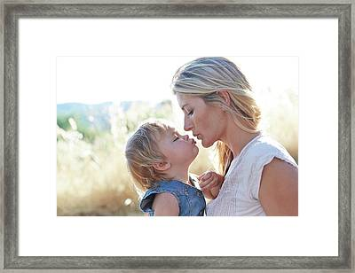 Mother Kissing Daughter Framed Print by Ruth Jenkinson