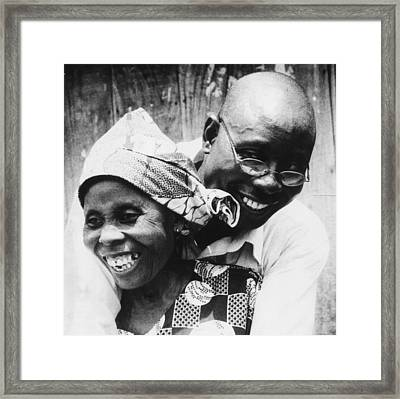 Mother Son Reunion Framed Print by Muyiwa OSIFUYE