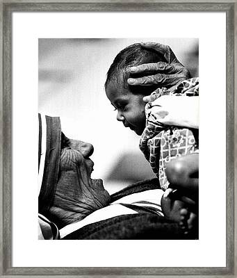 Mother Teresa Holds Baby Framed Print