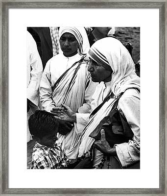 Mother Teresa With Young Boy Framed Print