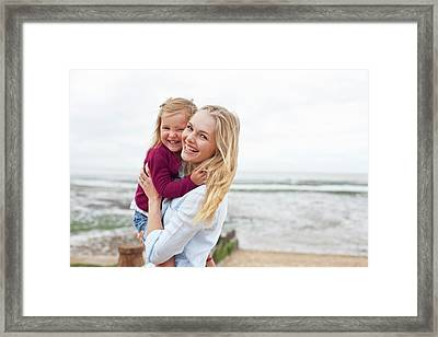 Mother With Daughter On Beach Framed Print by Ian Hooton